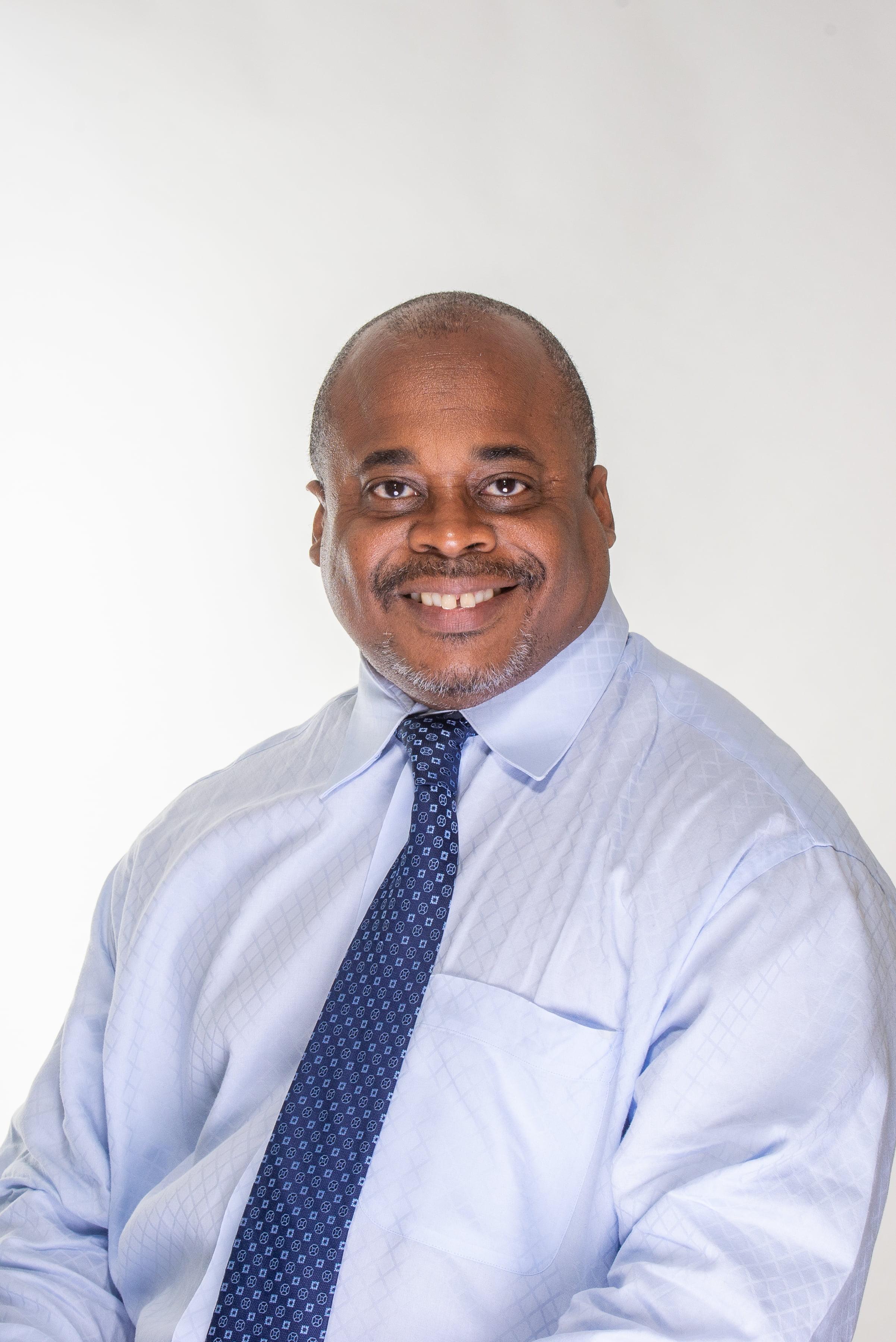 Dr. Adrian James